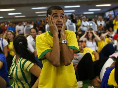 Brazil soccer fans react as they watch penalty shootout against Chile during a 2014 World Cup round of 16 game, at Guarulhos International Airport in Sao Paulo