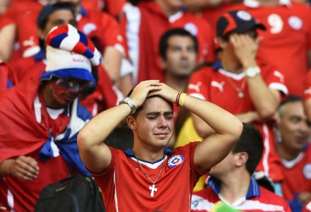 Fan of Chile reacts after losing their 2014 World Cup round of 16 game against Brazil at the Mineirao stadium in Belo Horizonte